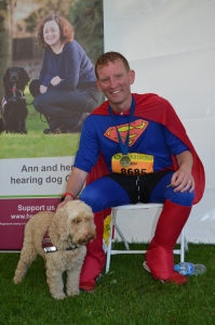 A hearing dog receives a SuperPat